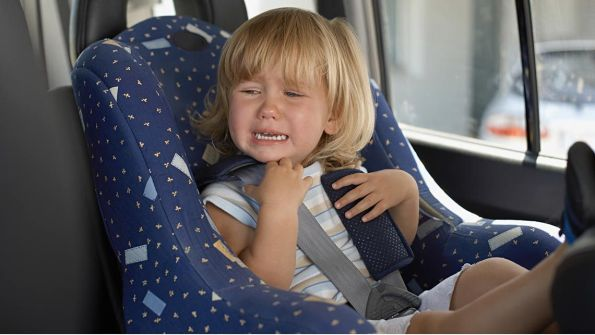 young-girl-crying-in-her-car-seat-D